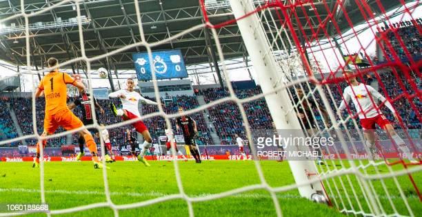 Leipzig´s Danish forward Yussuf Poulsen scores past Leverkusen´s Slowakian goalkeeper Lukas Hradecky and Brazilian defender Wendell during the German...
