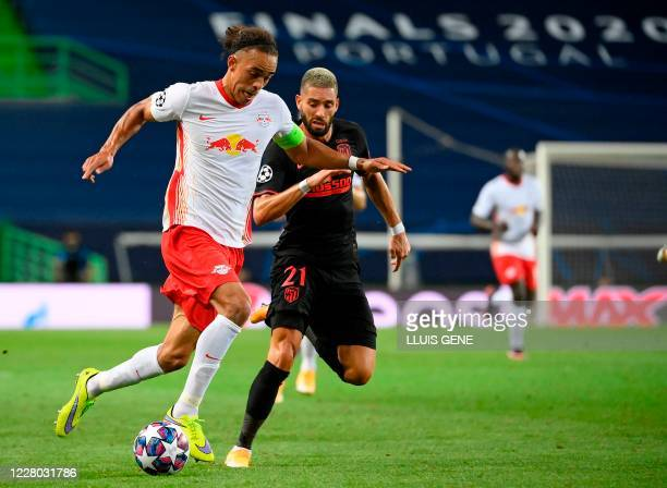 Leipzig's Danish forward Yussuf Poulsen vies with Atletico Madrid's Belgian midfielder Yannick Carrasco during the UEFA Champions League...