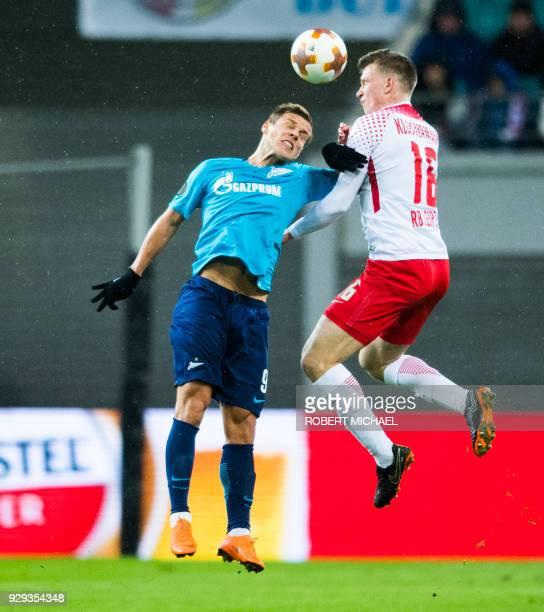 Leipzig's defender Lukas Klostermann and Saint Petersburg's forward Aleksandr Kokorin vie for the ball during the Europa League Round of 16 first leg...