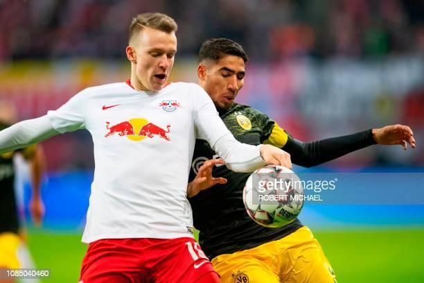 Leipzig's defender Lukas Klostermann vies with Dortmund's Moroccan defender Achraf Hakimi during the German first division Bundesliga football match...