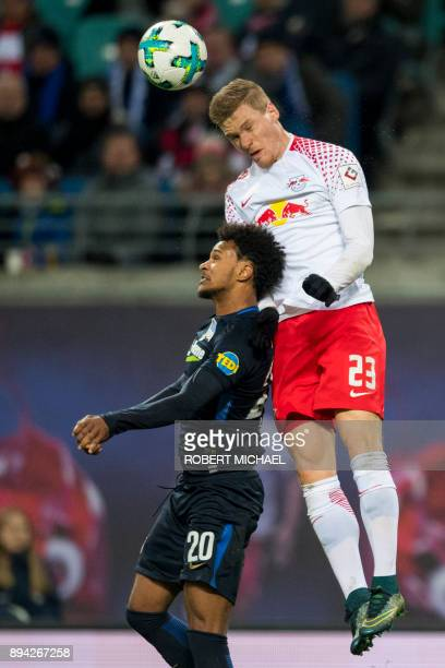 Leipzig's defender Marcel Halstenberg and Berlin's Austrian midfielder Valentino Lazaro vie for the ball during the German first division Bundesliga...