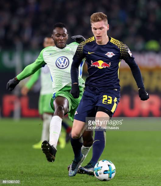 Leipzig's defender Marcel Halstenberg and Wolfsburg's French defender Josuha Guilavogui vie for the ball during the German first division Bundesliga...