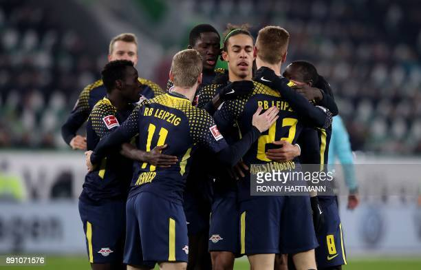 Leipzig's defender Marcel Halstenberg is congratulated by his teammates after scoring a goal during the German first division Bundesliga football...
