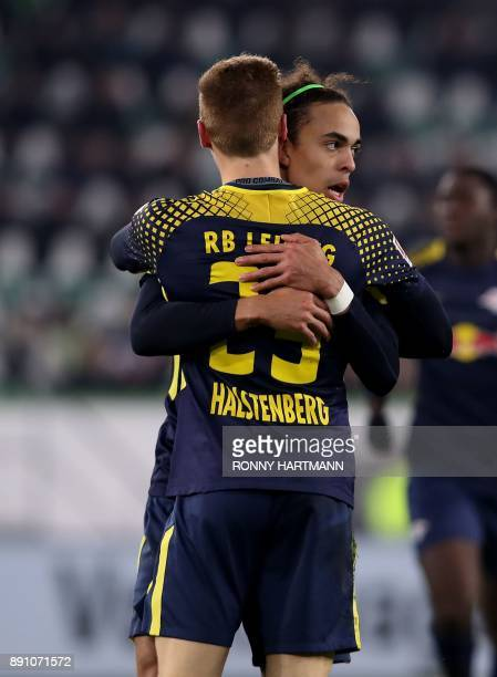 Leipzig's defender Marcel Halstenberg is congratulated by his teammate Danish forward Yussuf Poulsen after scoring during the German first division...
