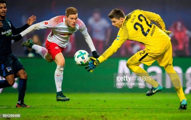TOPSHOT Leipzig's defender Marcel Halstenberg scores against Berlin's Norwegian goalkeeper Rune Jarstein during the German first division Bundesliga...