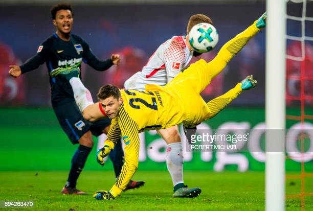 Leipzig's defender Marcel Halstenberg scores despite of Berlin's Norwegian goalkeeper Rune Jarstein during the German first division Bundesliga...