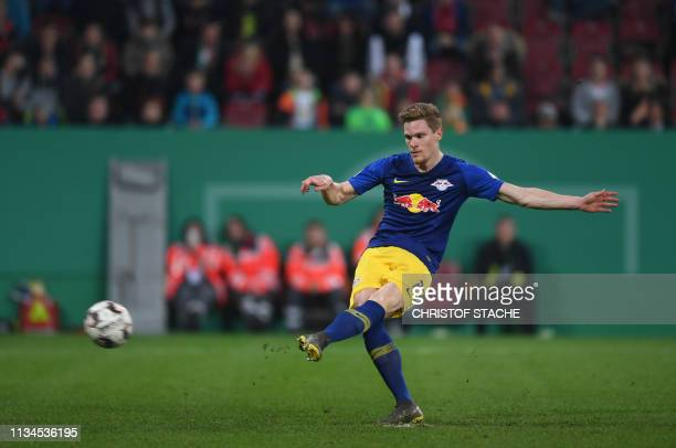 Leipzig's defender Marcel Halstenberg scores the penalty during extra-time of the German Cup quarter-final football match Augsburg v RB Leipzig on...
