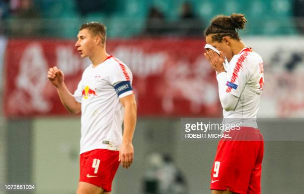 Leipzig's defender Willi Orban and Danish forward Yussuf Poulsen leave the field after the UEFA Europa League Group B football match between RB...