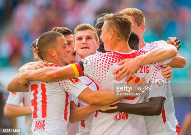 Leipzig´s defender Willi Orban celebrates after scoring the second goal for his team with his teammate striker Timo Werner and midfielder Diego Demme...