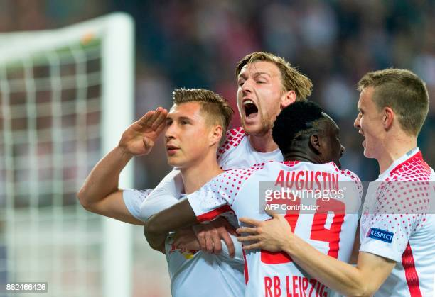Leipzig´s defender Willi Orban celebrates scoring the opening goal with his teammate Swedish forward Emil Forsberg French forward JeanKevin Augustin...