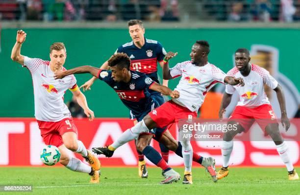 Leipzig´s defender Willi Orban Leipzig's Guinean midfielder Naby Keita Leipzig's French defender Dayot Upamecano Bayern Munich's French forward...