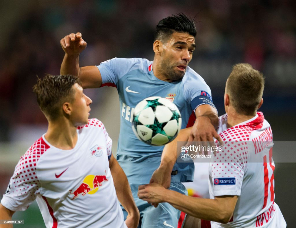 Leipzig´s defenders Willi Orban (L) and Lukas Klostermann (R) vie for the ball with Monaco's Colombian forward Radamel Falcao during the UEFA Champions League group G football match RB Leipzig v AS Monaco in Leipzig, eastern Germany on September 13, 2017. /