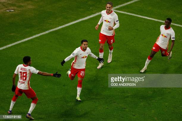 Leipzig's Dutch forward Justin Kluivert celebrates scoring the 3-0 goal with his teammates during the UEFA Champions League Group H football match RB...