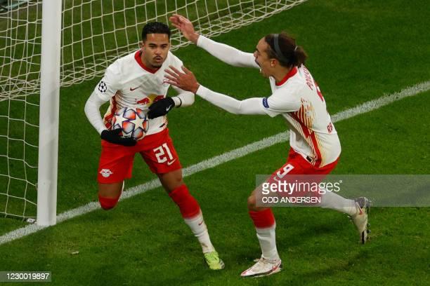 Leipzig's Dutch forward Justin Kluivert celebrates scoring the 3-0 goal with his teammate Leipzig's Danish forward Yussuf Poulsen during the UEFA...