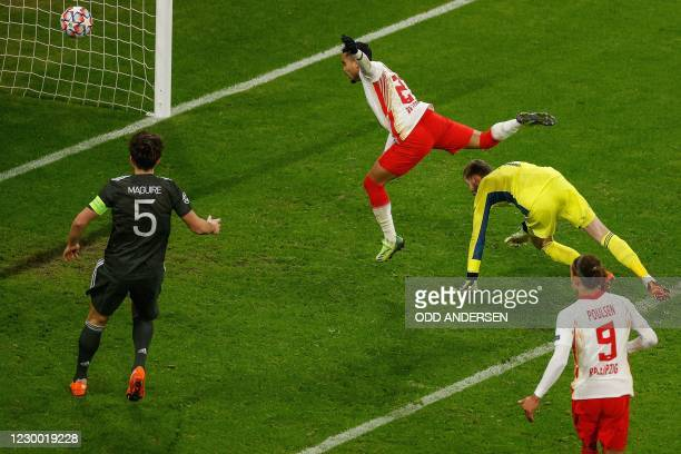 Leipzig's Dutch forward Justin Kluivert scores the 3-0 goal past Manchester United's Spanish goalkeeper David de Gea during the UEFA Champions League...