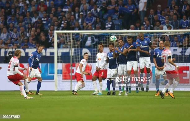 Leipzig's Emil Forsberg takes a free kick against Schalke during the German Bundesliga soccer match between FC Schalke 04 and RB Leipzig in the...