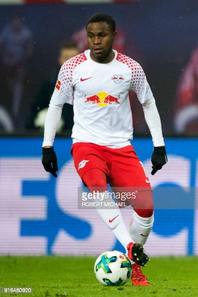 Leipzig's English midfielder Ademola Lookman runs with the ball during the German first division Bundesliga football match between RB Leipzig and FC...