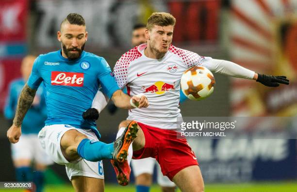 Leipzig's forward Timo Werner and Napoli's Italian Portuguese defender Mario Rui vie for the ball during the UEFA Europa League football match...