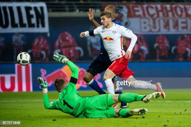 Leipzig's forward Timo Werner and Schalke's goalkeeper Ralf Faehrmann vie for the ball during the German first division Bundesliga football match...