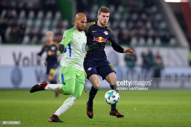 Leipzig's forward Timo Werner and Wolfsburg's US defender John Anthony Brooks during the German first division Bundesliga football match between VfL...