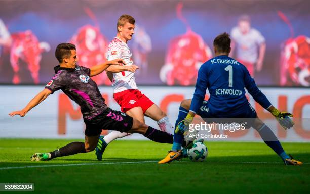 Leipzig's forward Timo Werner Freiburg's defender Marc Oliver Kempf and Freiburg's goalkeeper Alexander Schwolow vie for the ball during the German...