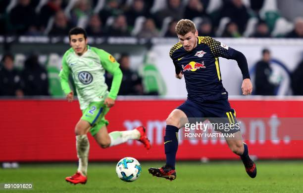 Leipzig's forward Timo Werner runs with the ball in front of Wolfsburg's Brazilian defender William during the German first division Bundesliga...