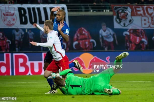 Leipzig's forward Timo Werner Schalke's Brazilian defender Naldo and Schalke's goalkeeper Ralf Faehrmann vie for the ball during the German first...