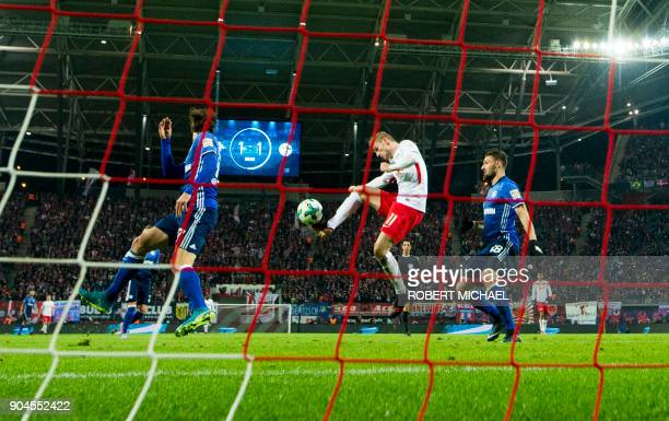 TOPSHOT Leipzig´s forward Timo Werner scores during the German first division Bundesliga football match between RB Leipzig and FC Schalke 04 in...