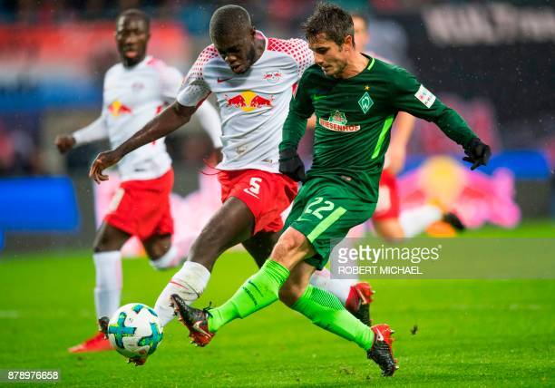 Leipzig's French defender Dayot Upamecano and Bremen's German midfielder Fin Bartels vie for the ball during the German First division Bundesliga...