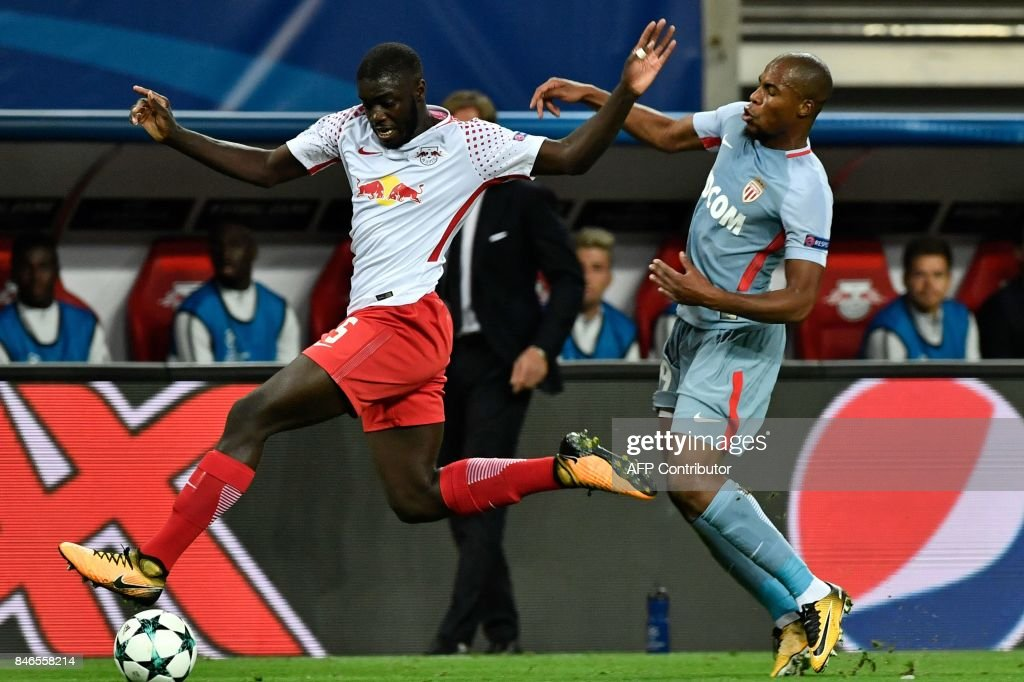 Leipzig's French defender Dayot Upamecano (L) and Monaco's French defender Djibril Sidibe vie for the ball during the Champions League group G football match RB Leipzig v AS Monaco in Leipzig, eastern Germany on September 13, 2017. / AFP PHOTO / John MACDOUGALL