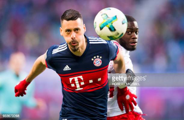 Leipzig's French defender Dayot Upamecano and Munich's forward Sandro Wagner vie for the ball during the German first division Bundesliga football...