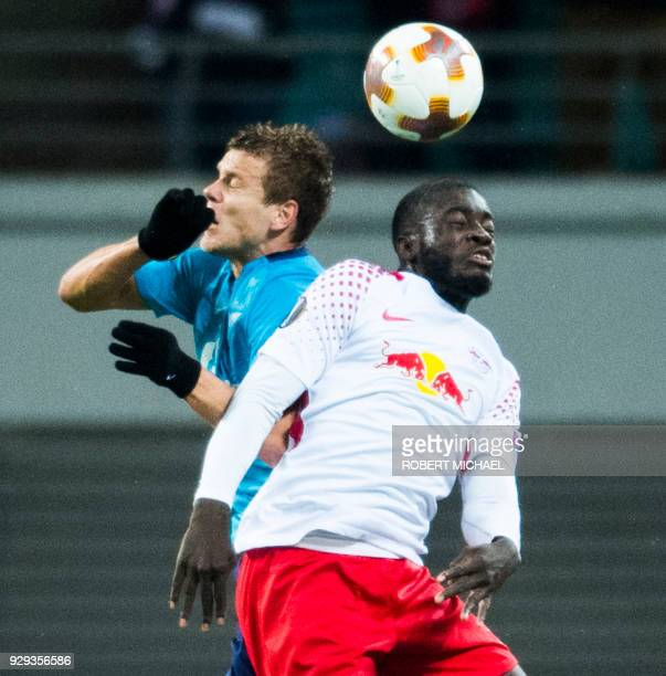 Leipzig's French defender Dayot Upamecano and Saint Petersburg´s forward Aleksandr Kokorin vie for the ball during the Europa League Round of 16...