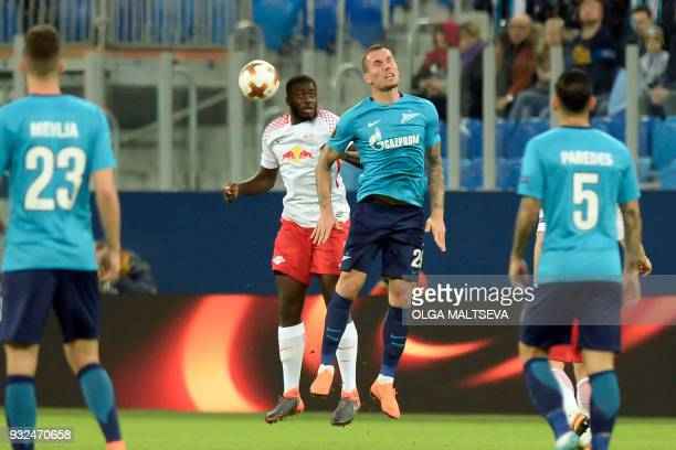 Leipzig's French defender Dayot Upamecano and Zenit St Petersburg's Anton Zabolotny vie for the ball during the UEFA Europa League Round of 16 second...