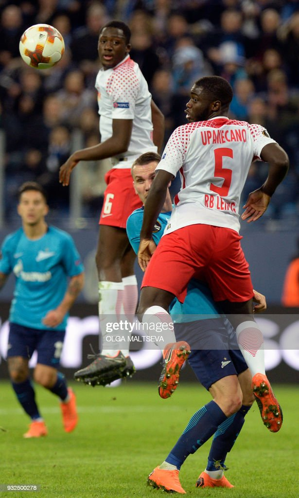 Leipzig's French defender Ibrahima Konate, Zenit St. Petersburg's Anton Zabolotny and Leipzig's French defender Dayot Upamecano vie for the ball during the UEFA Europa League Round of 16 second leg football match between FC Zenit and RB Leipzig on March 15, 2018 in Saint Petersburg. / AFP PHOTO / Olga MALTSEVA