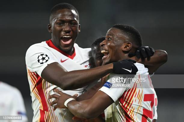Leipzig's French defender Nordi Mukiele celebrates scoring his team's second goal during the UEFA Champions League Group H football match between...