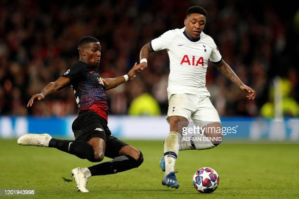 RB Leipzig's French defender Nordi Mukiele vies with Tottenham Hotspur's Dutch midfielder Steven Bergwijn during the UEFA Champions League round of...