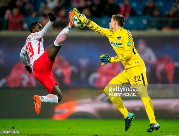 Leipzig's French forward JeanKevin Augustin and Berlin's Norwegian goalkeeper Rune Jarstein vie for the ball during the German first division...