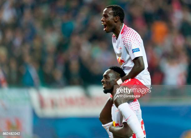 Leipzig´s French forward JeanKevin Augustin celebrates after scoring the 31 goal with his teammate Portuguese forward Bruma during the Champions...