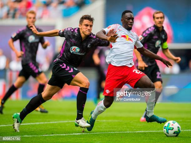 Leipzig´s French forward JeanKevon Augustin and Freiburg´s defender Marc Oliver Kempf vie for the ball the German first division Bundesliga football...