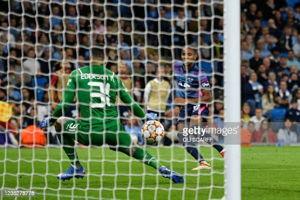 Leipzig's French midfielder Christopher Nkunku shoots the score his team's third goal, and his hat-trick during the UEFA Champions League 1st round...