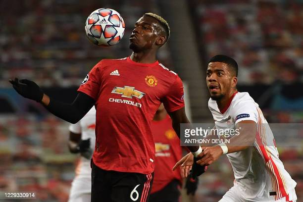 RB Leipzig's German defender Benjamin Henrichs vies with Manchester United's French midfielder Paul Pogba during the UEFA Champions league group H...
