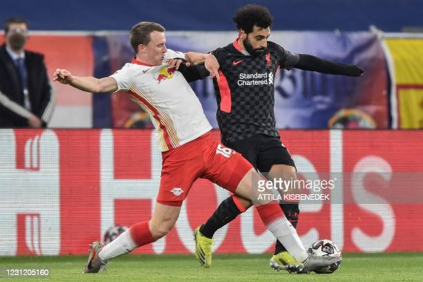 Leipzig's German defender Lukas Klostermann and Liverpool's Egyptian midfielder Mohamed Salah vie for the ball during the UEFA Champions League round...