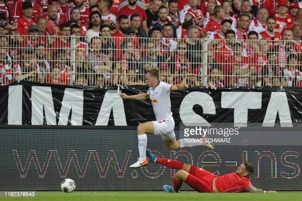 Leipzig's German defender Lukas Klostermann and Union Berlin's German midfielder Robert Andrich vie for the ball during the German first division...