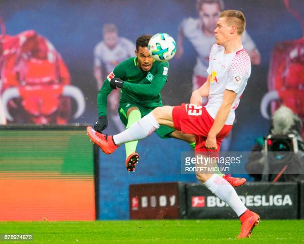 Leipzig's German defender Marcel Halstenberg and Bremen´s Czech defender Theodor Gebre Selassie vie for the ball during the German First division...