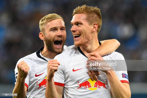 Leipzig's German defender Marcel Halstenberg celebrates after scoring a goal which was dissallowed following a VAR decision during the UEFA Champions...