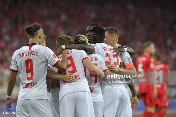 Leipzig's German defender Marcel Halstenberg celebrates scoring the opening goal with his teammates during the German first division Bundesliga...