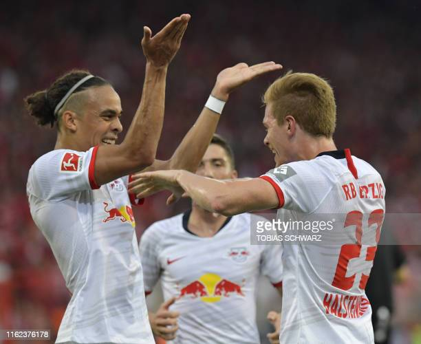 Leipzig's German defender Marcel Halstenberg celebrates scoring the opening goal with his teammate Leipzig's Danish forward Yussuf Poulsen during the...