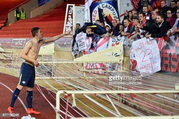 Leipzig's German defender Marcel Halstenberg gives his jersey to fan at the end of the UEFA Champions League group G football match between Monaco...
