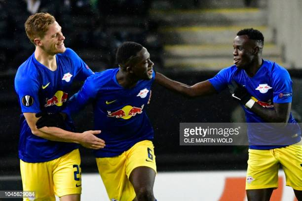 Leipzig's German defender Marcel Halstenberg Leipzig's French defender Ibrahima Konate and Leipzig's Portuguese forward Bruma celebrate scoring...