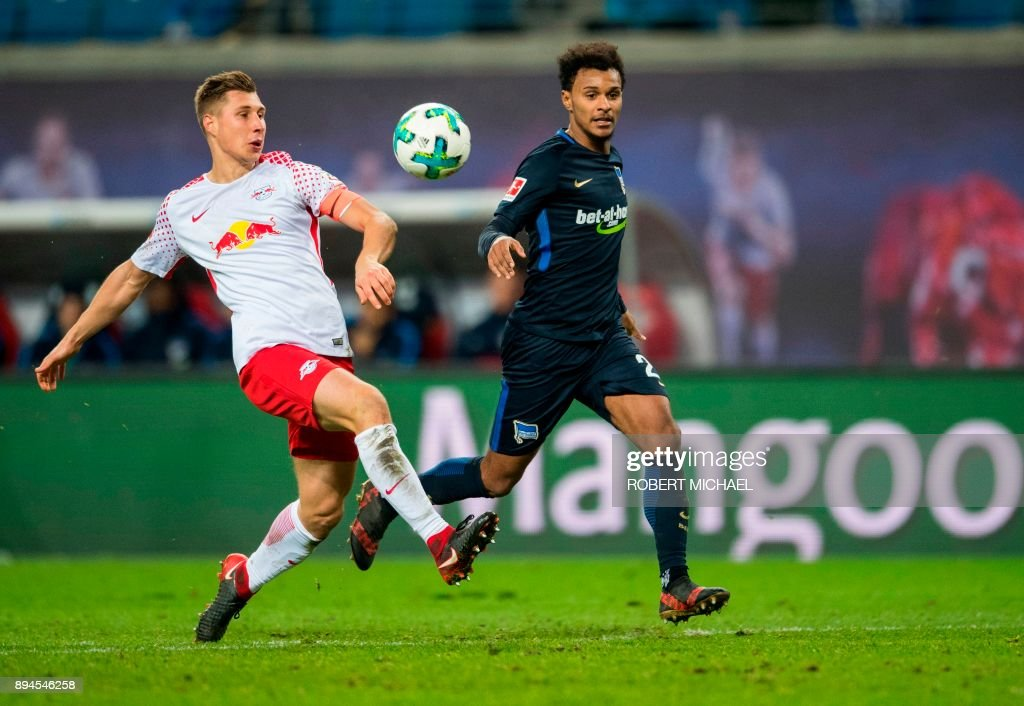 Leipzig's German defender Willi Orban (L) and Berlin's Austrian midfielder Valentino Lazaro vie for the ball during the German first division Bundesliga football match between RB Leipzig and Hertha BSC Berlin in Leipzig, eastern Germany on December 17, 2017. /